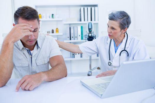 Doctor speaking to her sad patient