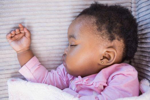 Little girl sleeping on the sofa