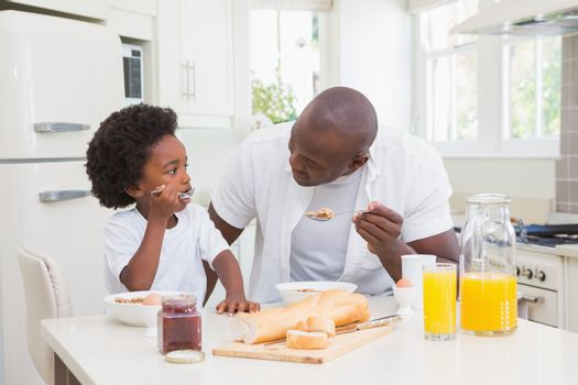 Father and son eating a breakfast