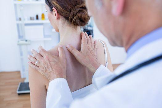 Doctor doing shoulder massage to his patient