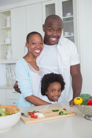 Portrait of a happy family preparing vegetables together