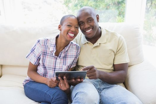 portrait of a happy smiling couple using digital tablet