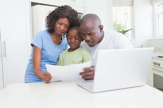 A family working and using his computer
