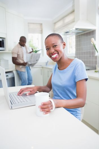 Portrait of a happy smiling pretty woman using her laptop