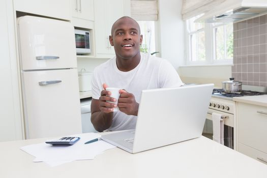 A man working and using his laptop