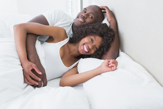A very cute couple in bed together
