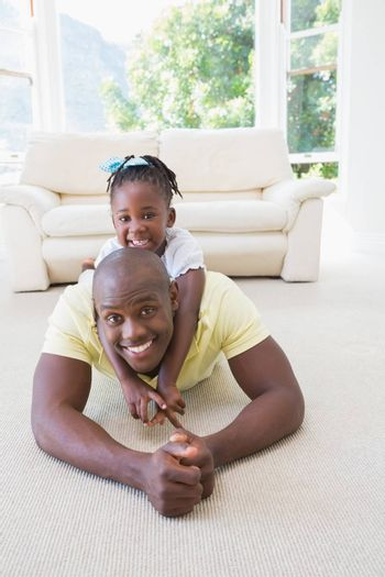 Happy smiling father with her daughter
