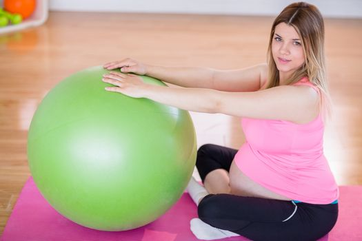 Pregnant woman doing exercise with exercise ball