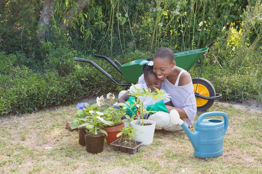 Happy smiling mother gardening with her daughter
