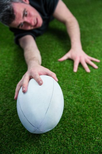 A rugby player scoring a try
