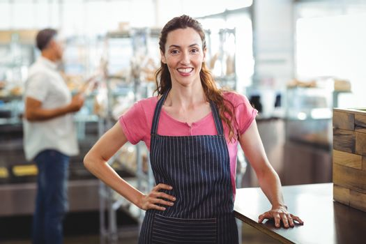 Pretty waitress leaning on counter