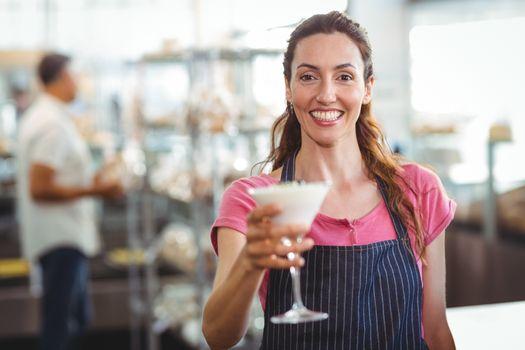 worker offering a parfait