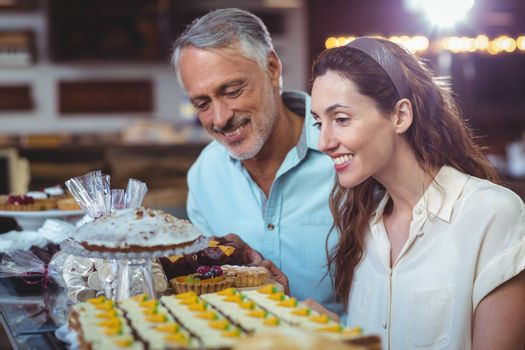 Cute couple looking at cakes