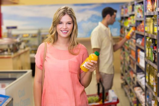 Portrait of a pretty smiling blonde woman buying product