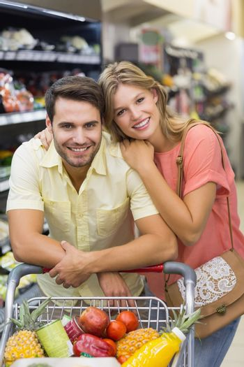 Portrait of smiling bright couple buying products