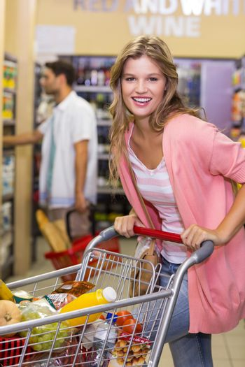 Portrait of a smiling blonde woman buying a products