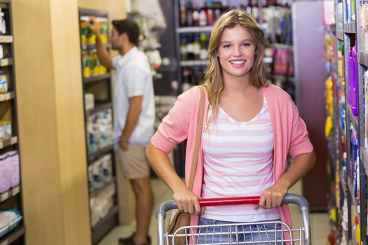 Portrait of smiling blonde woman buying products