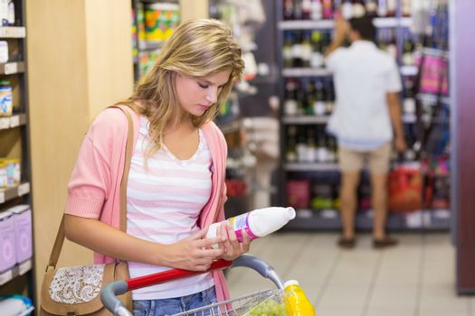 Pretty young woman buying a products
