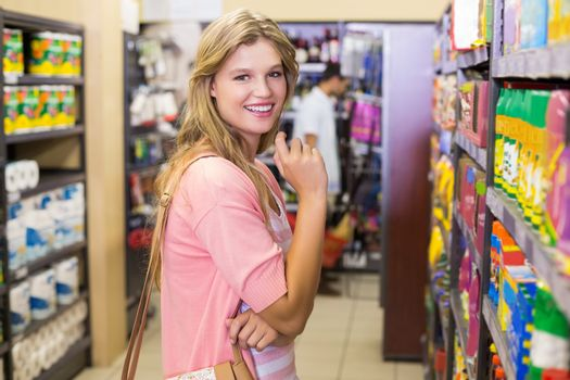 Portrait of a smiling young woman buying a products