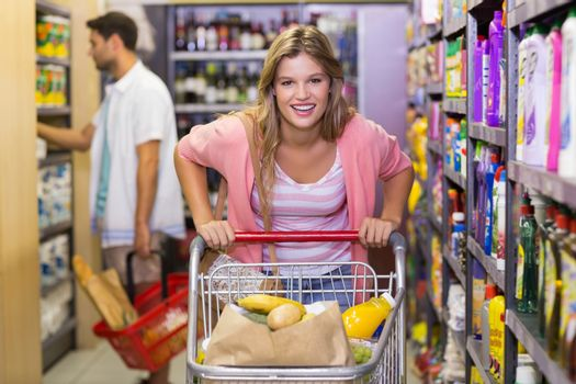 Portrait of smiling pretty blonde woman buying products