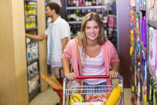 Portrait of a smiling pretty woman buying products