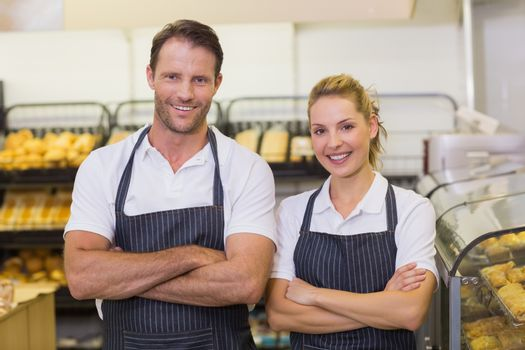 Portrait of a smiling bakers with arms crossed