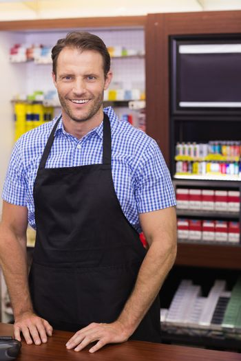 Portrait of a smiling handsome with an apron