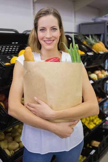 A pretty blonde with a grocery bag