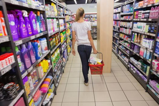 Woman walking with his trolley on aisle