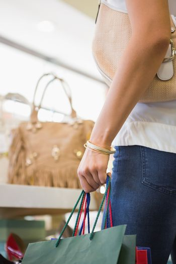 Close up of woman browsing bags