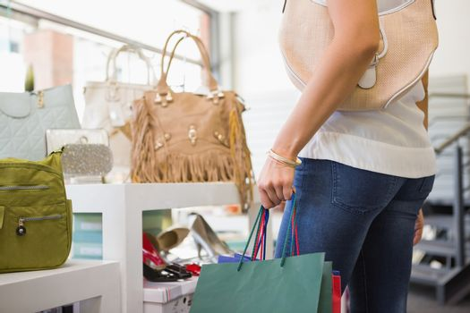 Woman browsing bags