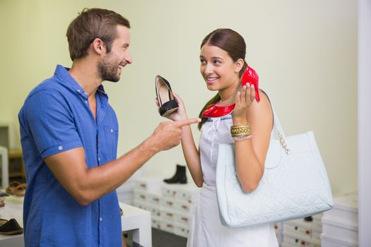 Young couple deciding on which shoe to choose