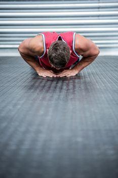 Muscular man doing push-ups