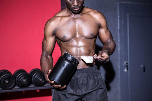 Young Bodybuilder filling his Bottle