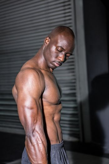 Young Bodybuilder looking at his muscles