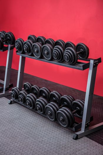 Black weights on a stand