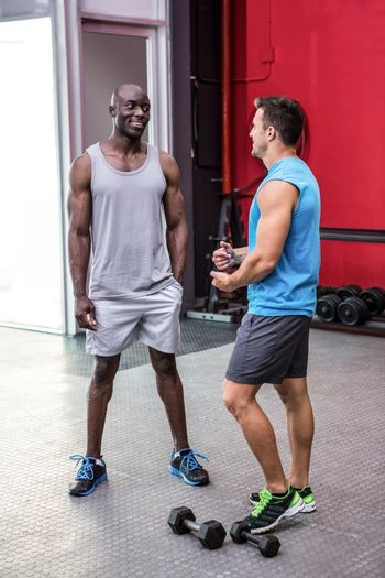 Young bodybuilder talking to each other