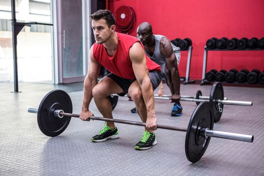 Three young Bodybuilders doing weightlifting