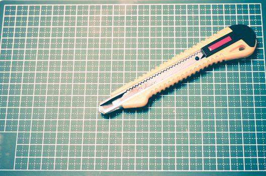 cutter knife on cutting board