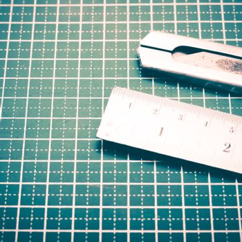 ruler and cutter on cutting mat