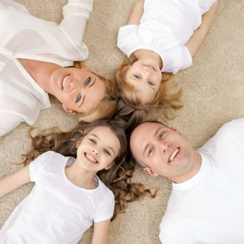 parents and two girls lying on floor at home