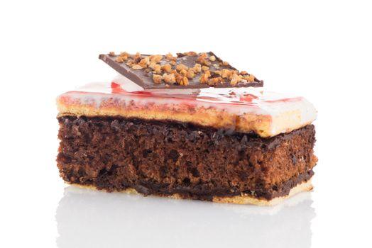 Piece of chocolate cake on white background