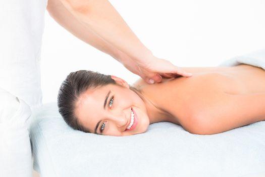 Pretty brunette enjoying a massage
