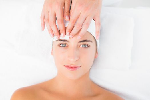 Hand waxing beautiful womans eyebrow