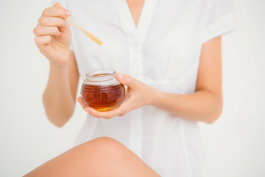 Woman holding hot wax in bowl