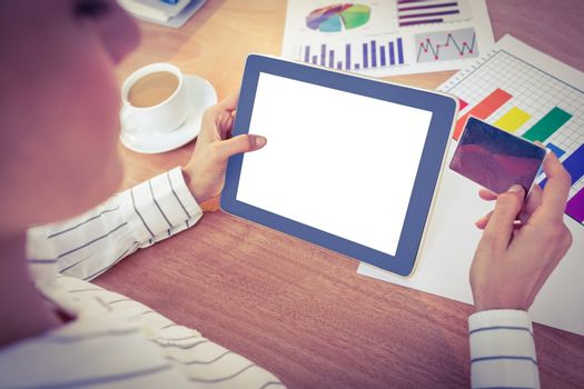 Businesswoman using her digital tablet