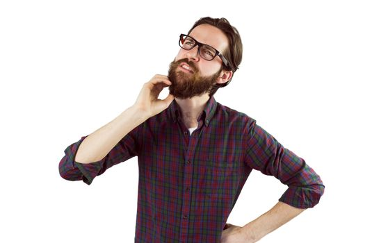 Handsome hipster thinking and scratching beard