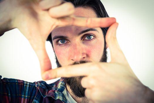 Handsome hipster framing with hands