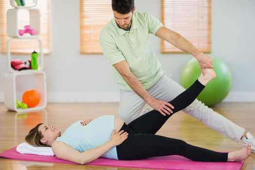 Pregnant woman getting relaxing massage