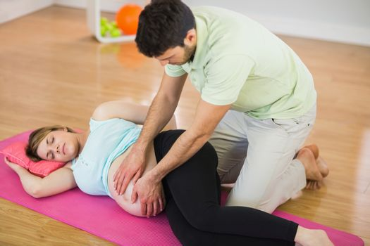 Pregnant woman getting massage for pregnant belly